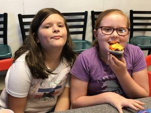 Girls eating cupcakes
